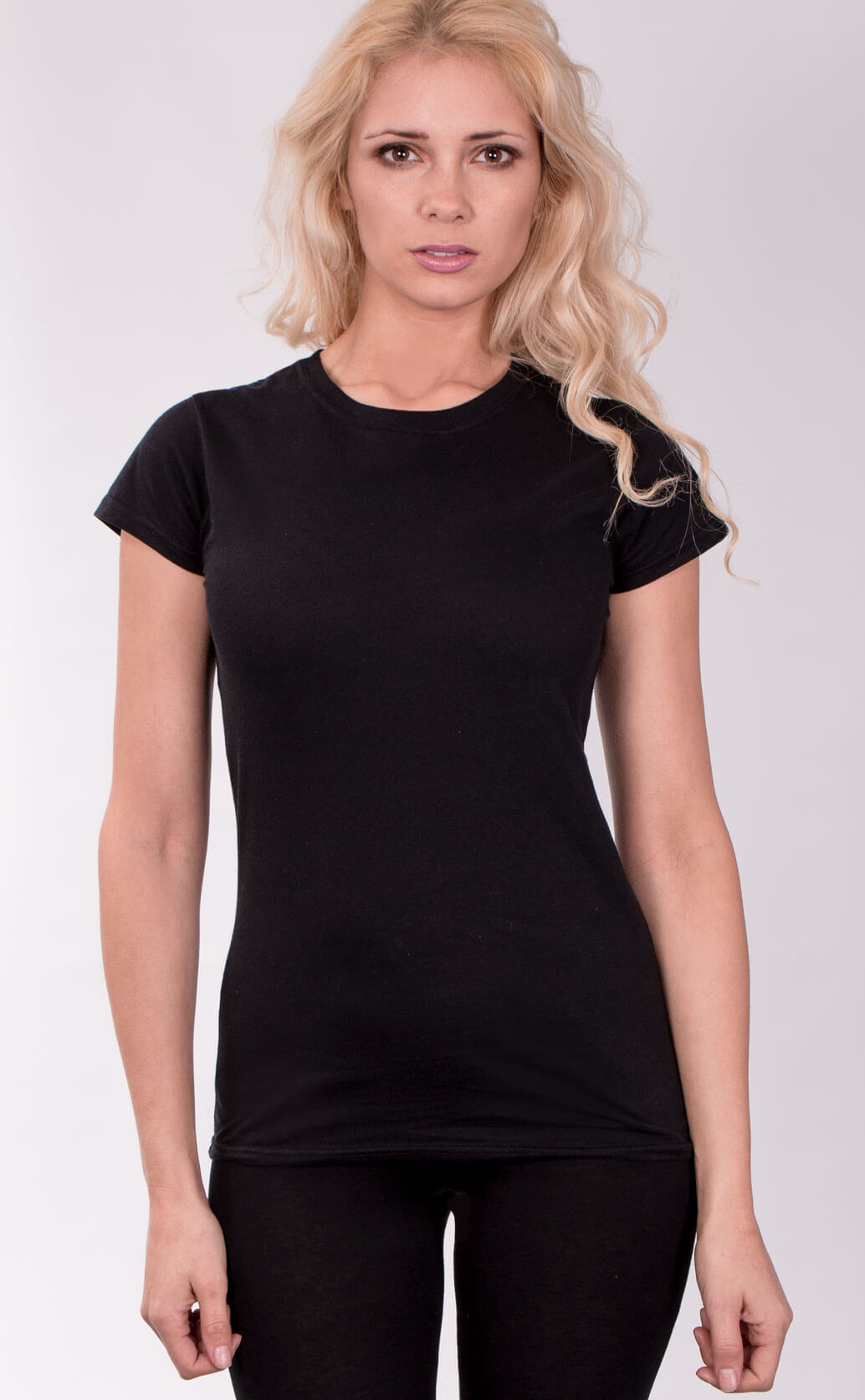 Size guide image for Lady Fit shirt type. Model is dressed in black