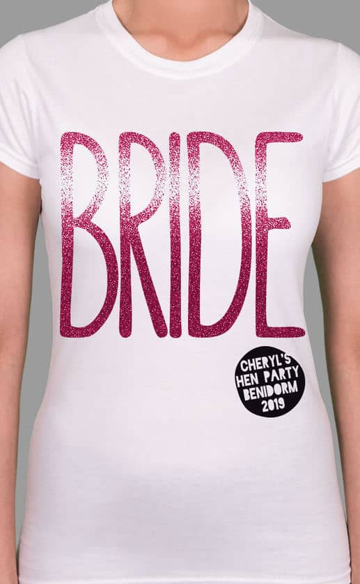 Image to buy product Bride Glitter Personalised Hen Party T Shirt. Large lettering in glitter pink print with subtext in black on a white lady fit t-shirt.