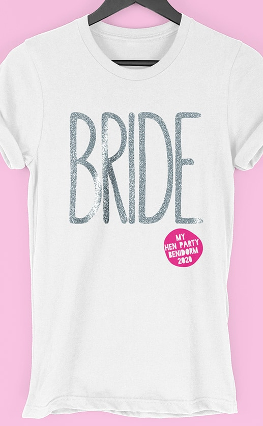 Image to buy product Bride Glitter Personalised Hen Party T Shirt. Large lettering in glitter silver print with subtext in fuchsia on a white t-shirt.