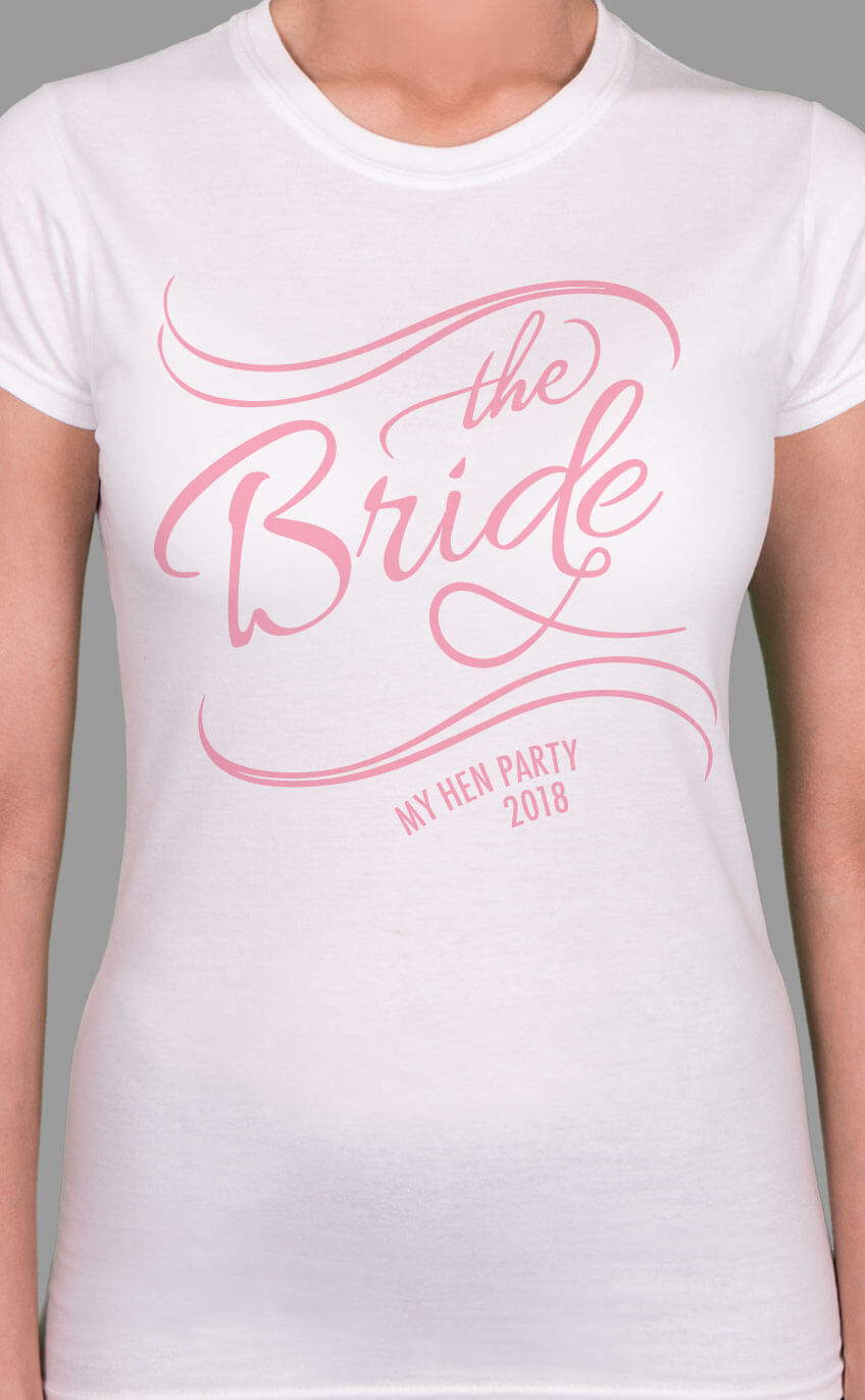 Image to buy product Bride's Posse - The Bride Personalised Hen Party T Shirt. A bride's version of the design in script lettering in baby pink print on a white lady fit t-shirt.