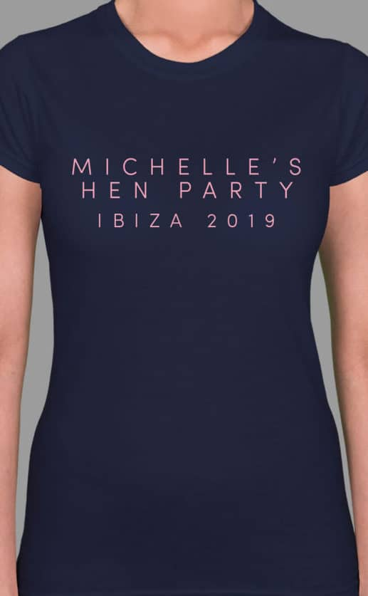 Image to buy product Light Type Personalised Hen Party T Shirt. Sans serif font in baby pink print on a navy lady fit t-shirt.