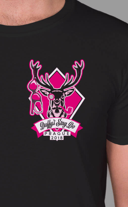 Small top left stylised illustration of a stag with horns, monocle and pipe. Personalised script text underneath. Fuchsia print on black t-shirt