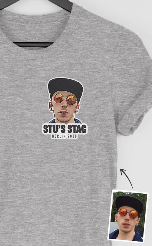 Small top left stylised photograph of the stag's face. Personalised text underneath. Full colour print on grey t-shirt