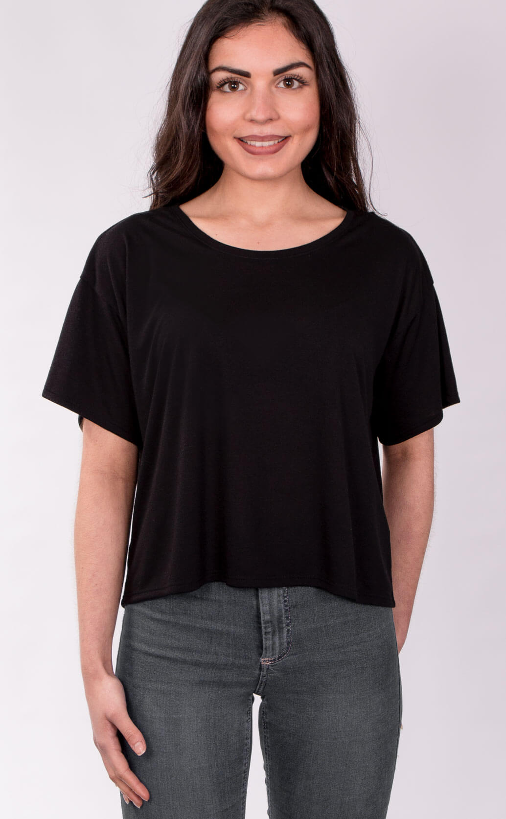 Size guide image for Flowy Boxy Tee shirt type. Shot from the front. Model is dressed in black