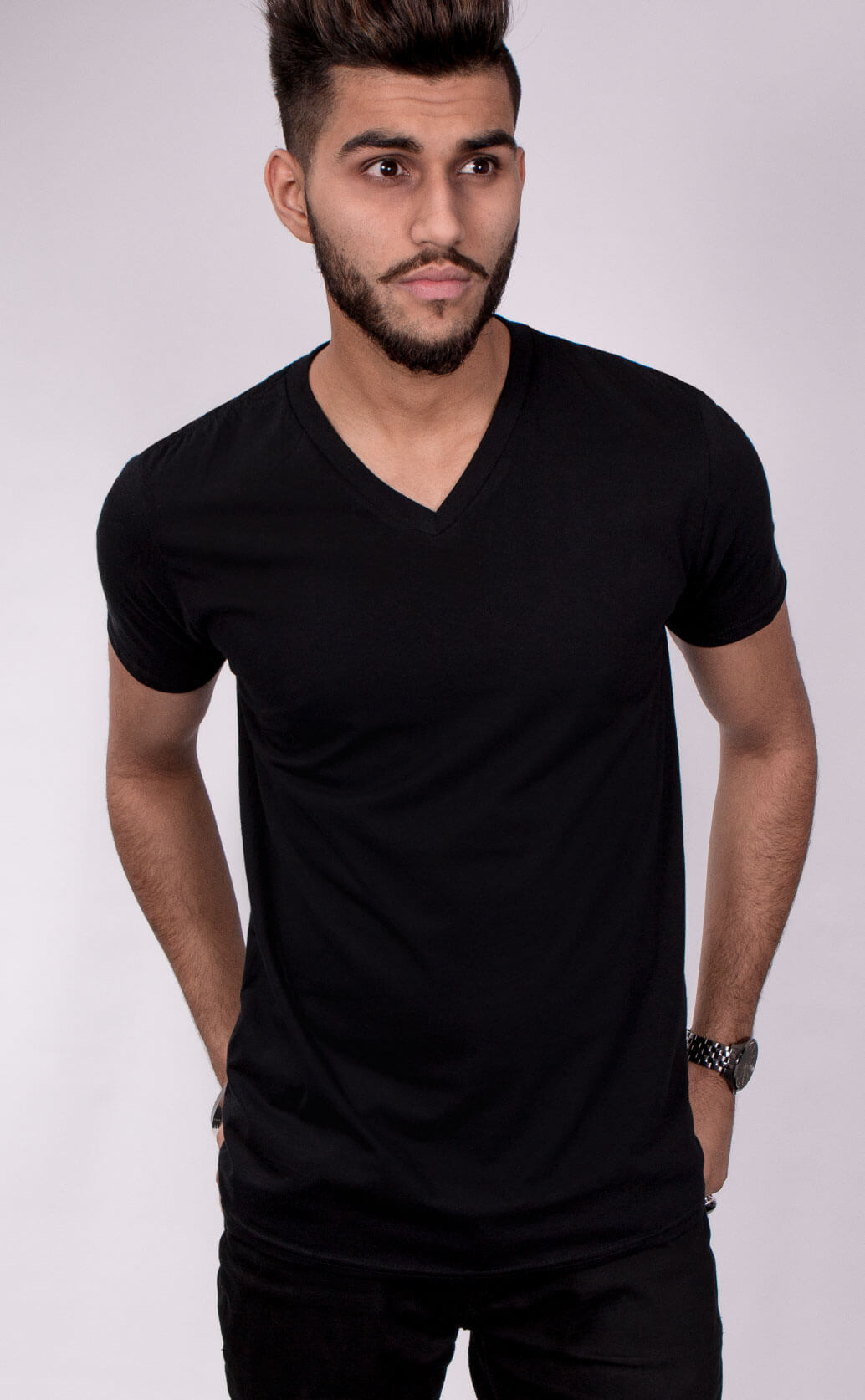 Size guide image for Mens Style Fit V Neck shirt type. Model is dressed in black