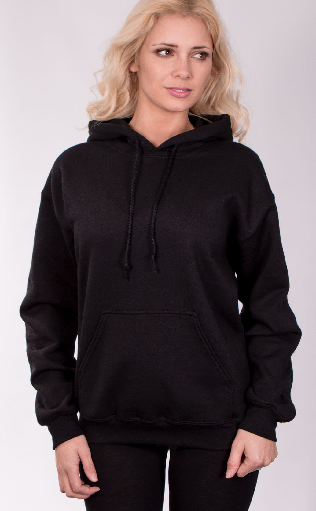 Size guide image for Unisex Hoodie ladies shirt type. Shot from the front. Model is dressed in black
