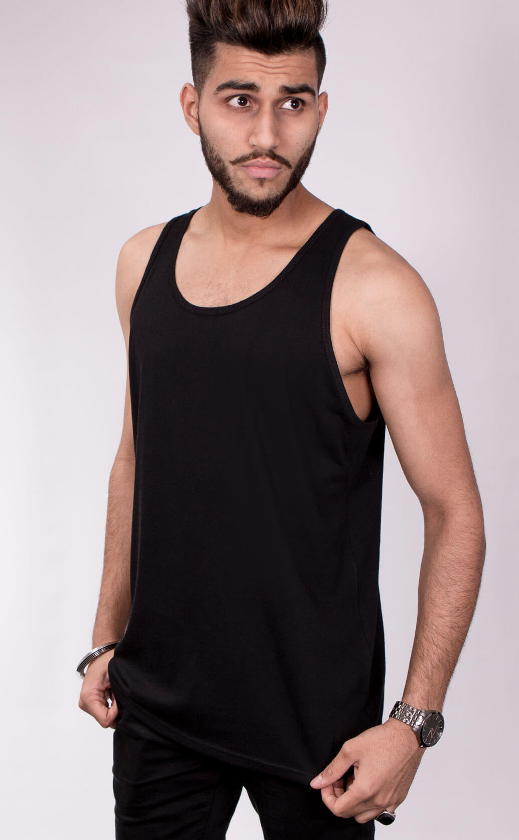 Size guide image for Unisex Vest mens shirt type. Model is male and dressed in black