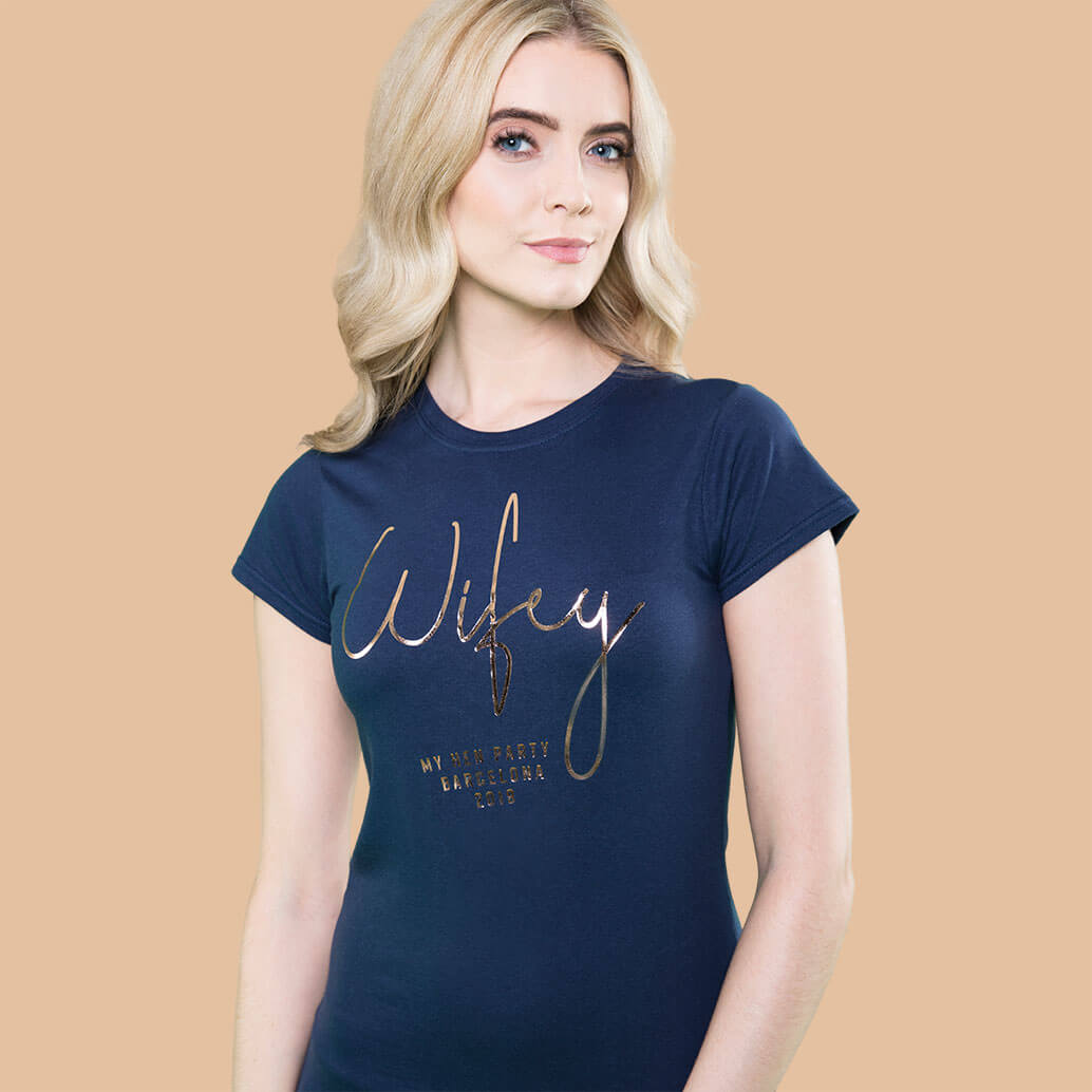 About Mr Porkys female model wearing Wifey hen party t shirt in navy with gold foil print