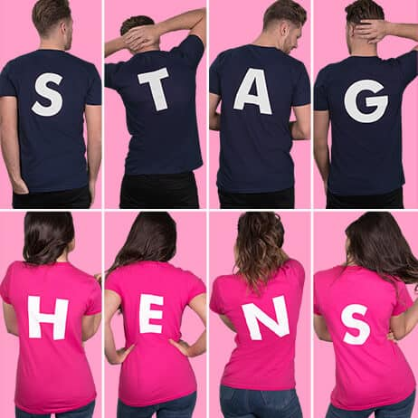 Top row shows examples of back letter extra prints, spelling out STAG. White print on navy t shirts. Bottom row shows hen t shirts from behind with back letters, spelling out HENS. White print on fuchsia lady fit t shirts