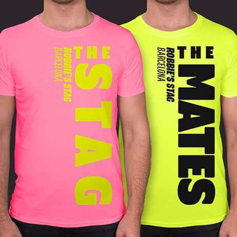 Shirt in the foreground is Stag Side design in neon yellow print on neon pink t shirt. Secondary t shirt is in neon yellow with The Mates design printed in black